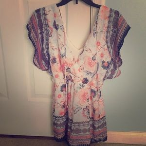 Romper. Only worn once. Size Small.